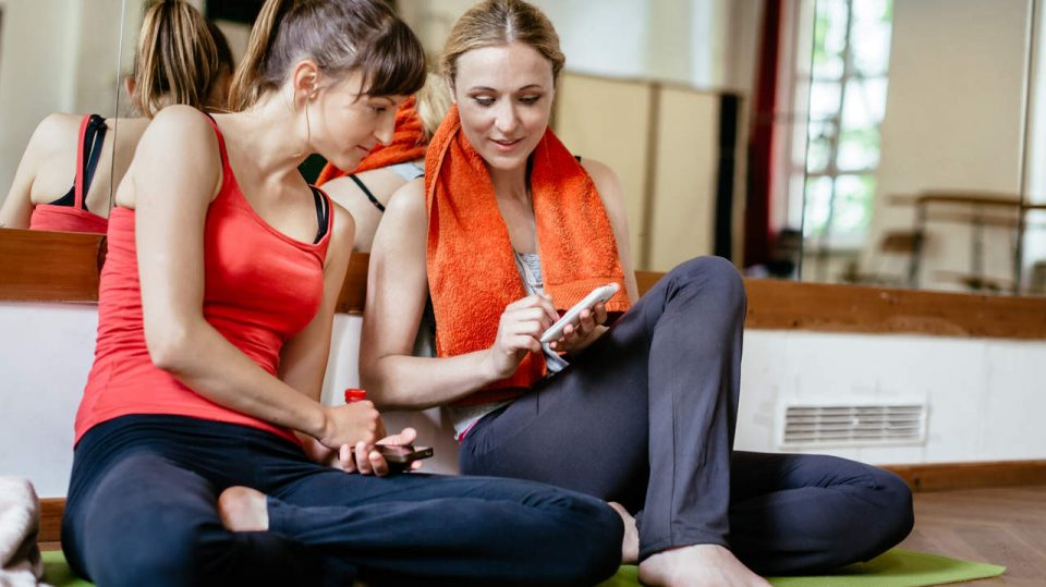 Women With Smart Phone After Fitness Workout